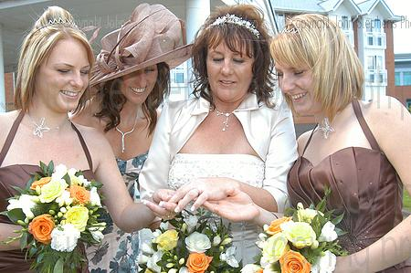 bride shows ring to bridesmaids,arden hotel nec solihull bickenhill, wedding photography & video