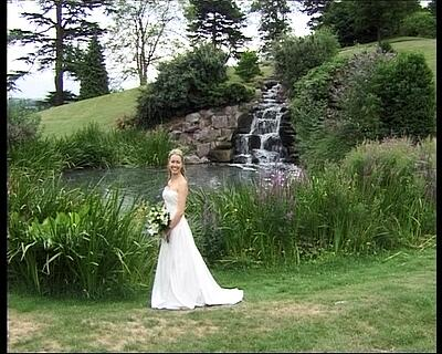 Welcombe Hotel Stratford upon Avon - emma-jo and damian full straight on shot of waterfalls,wedding video welcombe